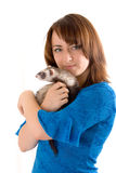 Girl with a polecat. Portrait of the girl with a domestic polecat on hands royalty free stock image