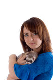 Girl and polecat Royalty Free Stock Photography