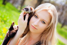 Girl with a polecat Stock Photo