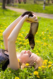 Girl with a polecat. Portrait of the girl with a domestic polecat on hands stock photography
