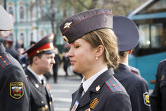 The girl police officer in the city of St. Petersburg. St. Petersburg, Russia - May 9: The girl police officer costs in a cordon on Palace Square during parade stock images