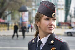 The girl police officer in the city of St. Petersburg. St. Petersburg, Russia - May 9: The girl police officer costs in a cordon on Palace Square during parade stock photo