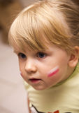 Girl with Polish flag on face. Portrait of cute young Polish girl with flag painted on face stock photo