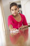 Girl Polishing Table At Home Stock Photos
