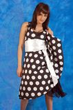 Girl in polka-dot dress Stock Images