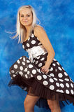 Girl in polka-dot dress Stock Photo