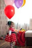 Girl in polka-dot dress Stock Images