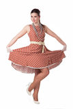 Girl in polka-dot dress. Retro style Royalty Free Stock Photo