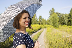 Girl in polka dot dress under the scorching sun Royalty Free Stock Photography