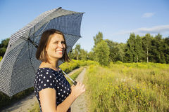Girl in polka dot dress under the scorching sun Royalty Free Stock Images