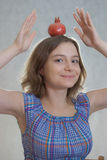 Girl with pomegranate Stock Images