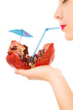 Girl with pomegranate and straw drinking Royalty Free Stock Image