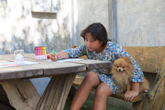 Girl and pomeranian dog at home Royalty Free Stock Photography