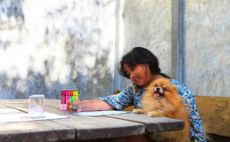 Girl and pomeranian dogs in home garden Royalty Free Stock Image