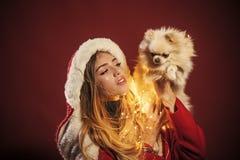 girl with pomeranian spitz dog at xmas.