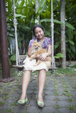 Girl and pomernian dog Stock Image