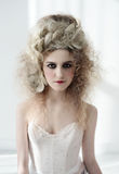 Girl in pompadour-style pompadour with a great haircut and a corset. Baroque and Rococo spirit. Stock Photography