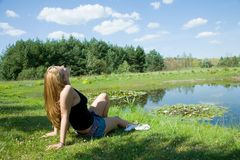 The girl at a pond Royalty Free Stock Photos