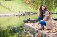 Girl by the pond Stock Photography