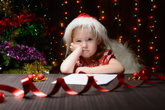 Girl pondered letter to Santa Claus Stock Photography