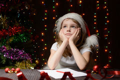 Girl pondered letter to Santa Claus Royalty Free Stock Photography