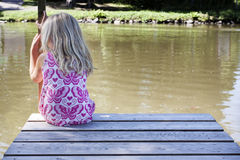 Girl on pontoon Royalty Free Stock Image