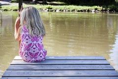 Girl on pontoon royalty free stock image