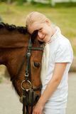Girl and pony. Young girl with her pony Stock Image