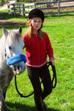 Girl and pony. Young girl leading her pony out to pasture Royalty Free Stock Image
