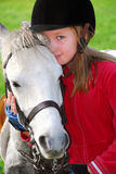 Girl and pony. Portrait of a young girl with a white pony Royalty Free Stock Photo