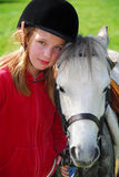 Girl and pony. Portrait of a young girl with a white pony Royalty Free Stock Images