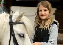 Girl with pony. Portrait of little girl with pony Royalty Free Stock Image