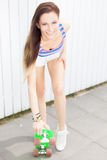 Girl with pony skateboard Royalty Free Stock Photo