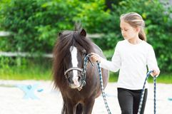 Girl and pony. For a walk Royalty Free Stock Photos