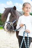 Girl and a pony for a walk Royalty Free Stock Images