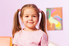 Girl with ponytails smile and pose Stock Images