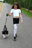 Girl and poodle dog Stock Images