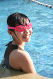 Girl at the pool. Girl wearing pink goggles in the swimming pool Royalty Free Stock Images