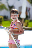 Girl and pool. Girl walking out pool smiling Stock Image