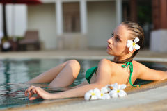 Girl in pool Stock Photos