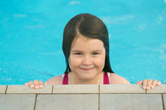Girl at the pool stock photography