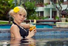 Girl in the pool Stock Photos