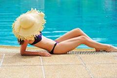 Girl in pool Stock Image