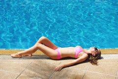 Girl at pool Stock Image