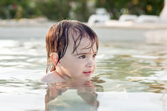 Girl in the pool Royalty Free Stock Images