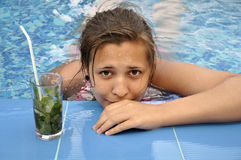 Girl in pool Stock Image