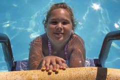 Girl in the pool Stock Photos