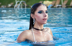 Girl in pool. Young woman beauty portrait in water Royalty Free Stock Images