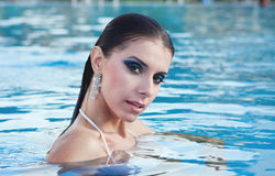 Girl in pool. Portrait of a beautiful girl in the pool Stock Photos