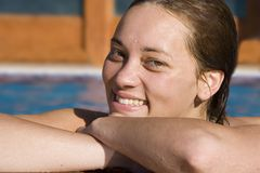 Girl by the pool. Smiling royalty free stock photos
